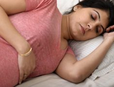 A Pregnant Woman In A Deep Sleep.