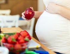 A Pregnant Woman Eating Fresh Fruits.
