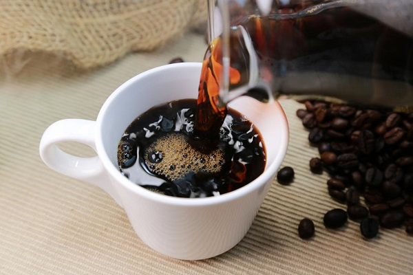A Dark Brown Coffee - Reduce Intake Of Caffeine During Pregnancy.