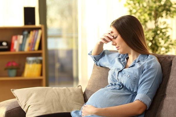 A Pregnant Woman Suffers By A Severe Headache.