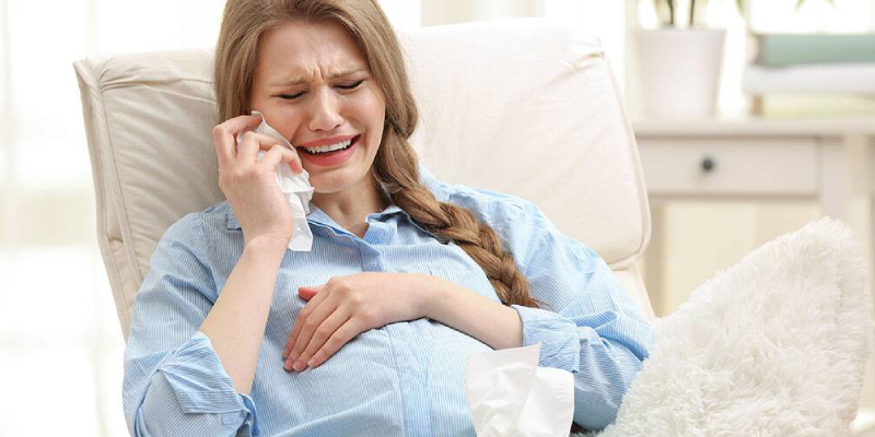 A Woman Crying During Her Pregnancy Time.