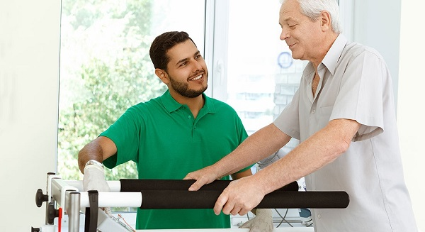 A Physiotherapist Treats His Senior Patient.
