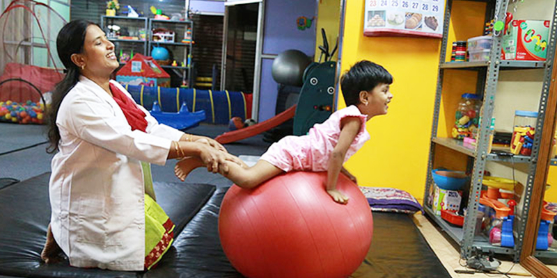 Kid Exercising In Physiotherapy Session.