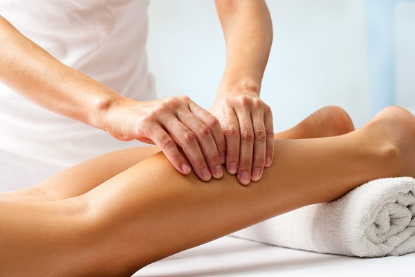 A Physiotherapist Work With Woman Legs.