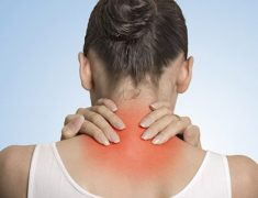 A Woman With Severe Back Neck Pain.