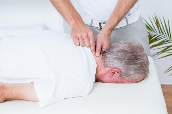 A Therapist Senses The Pain Nerve In A Senior Citizen's Neck.